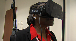 Melinda Person demonstrates how a virtual reality headset was used for a rece...