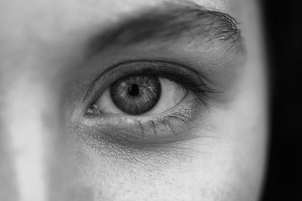 A woman's eye is pictured in this black and white photogr...