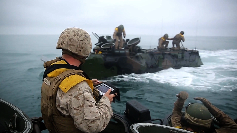 Marines with the amphibious assault vehicle platoon conduct a mock casualty e...