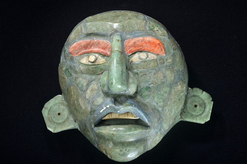 Archaeologists found this mask in a tomb in Belize. During ceremonies, royalt...