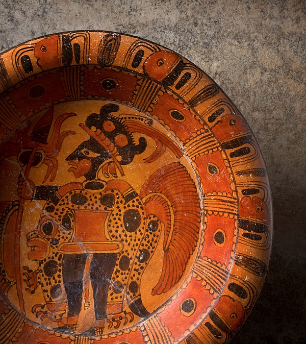 This brightly colored plate made for burial with the dead...