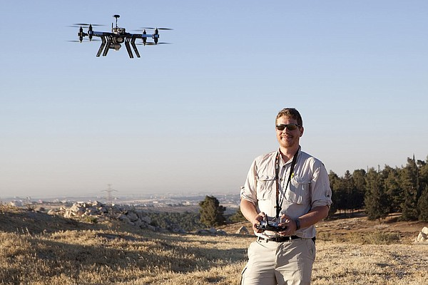 Matthew Vincent flies a drone in Tall al-'Umayri, Jordan.