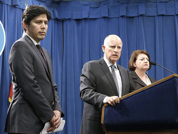 Gov. Jerry Brown answers a question about the budget agre...