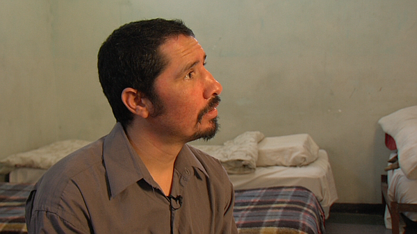 Misael Soto sits on his bed at the rehabilitation center ...