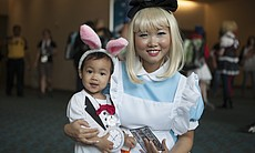 A mother and daughter in costume at Comic-Con, ...