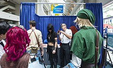 A woman gets her fake weapon checked at Comic-C...