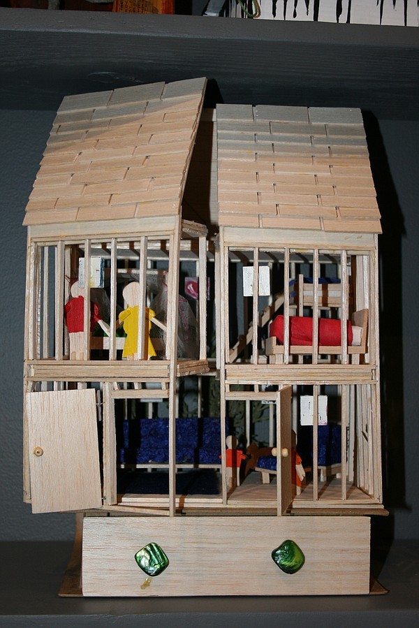 A dollhouse wood sculpture created by James Fox, an inmate at Donovan state p...