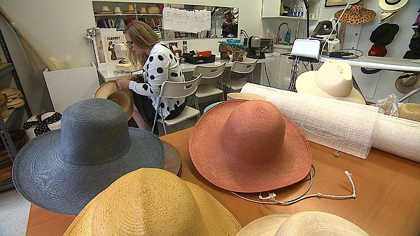 Jill Courtemanche works on hand-crafted straw hats, made ...
