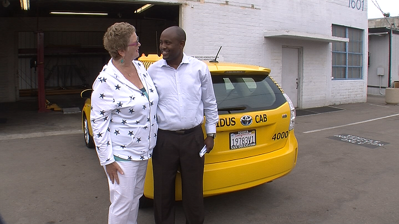 Cabdriver Adane Anjulo thanks San Diego Councilwoman Marti Emerald on July 14...
