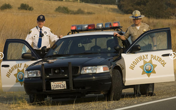 A senior volunteer (left) with the California Highway Pat...