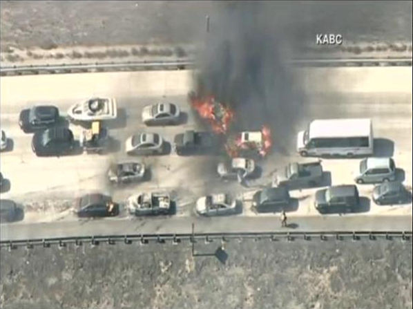 A brush fire ignited cars on Interstate 15 July 17, 2015.