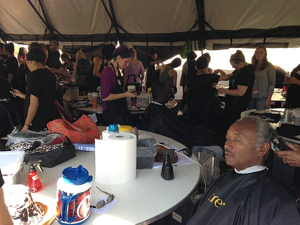 A veteran gets his hair cut at the 28th Stand Down event,...