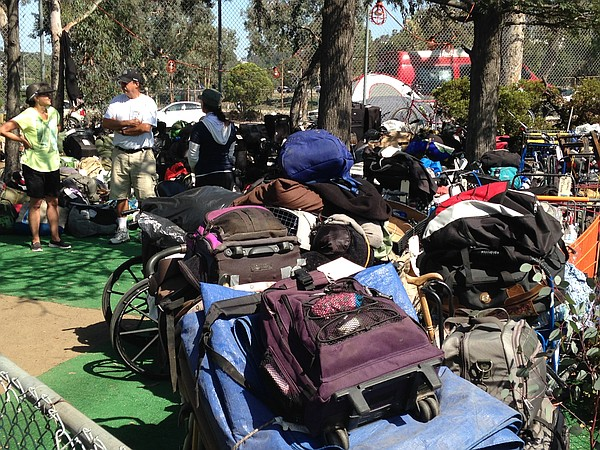 The belongings of homeless veterans are stored in an area...