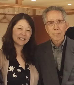 Akiko Mikamo stands with her father, Shinji Mikamo, in this undated photo.