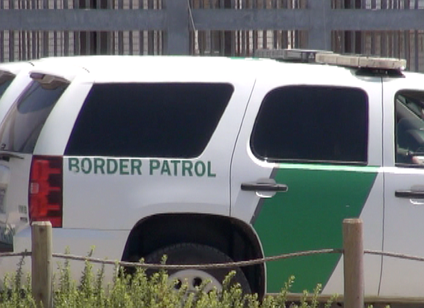 A U.S. Customs and Border Protection truck is shown parked next to fence at F...