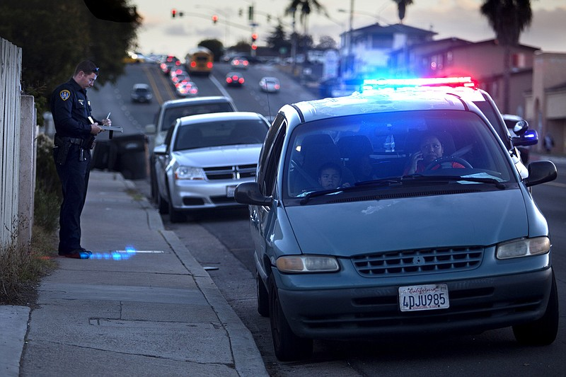 A San Diego police officer pulls over a driver in Valencia Park in this undat...