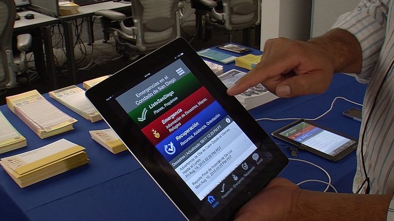 A San Diego County employee scrolls through the new Spanish-language version ...