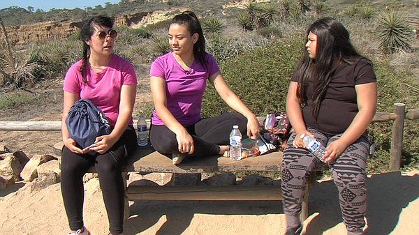 Sarabi Rodriguez and a classmate sit with Evelin Sanchez ...