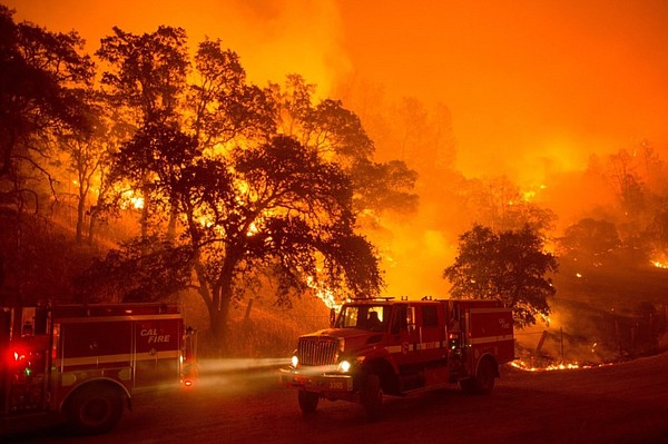 A fire truck moves position as flames from the Rocky fire...