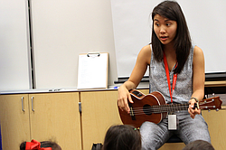 Zoe Kumagai, 23, a new music teacher at Veterans Elementary School in Chula Vista, California, instructs a group of kindergarten students.