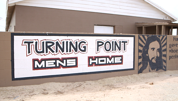 A mural welcoming people to Turning Point Men's Home in H...