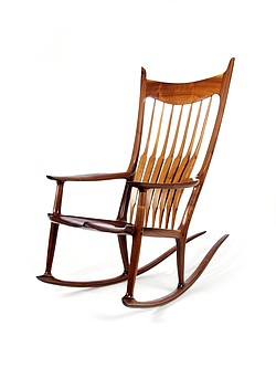An image of furniture craftsman Sam Maloof's iconic rocking chair, now on view at the Mingei International Museum in Balboa Park.