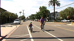 A father and son ride down a bike lane next to Coronado's elementary school, Sept. 22, 2015.