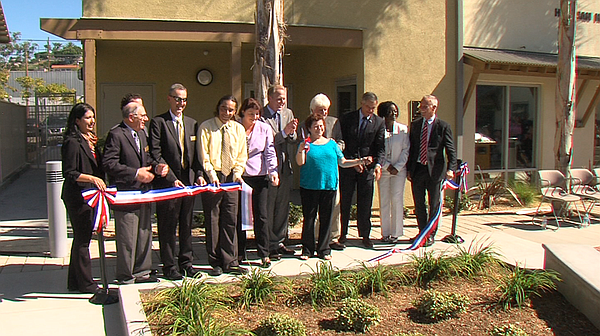 Diane Hickman cuts the ribbon for Hickman Hall, named after her husband Jim H...