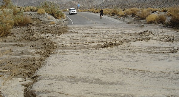 Mud and water flow across Highway 78 in San Diego County.