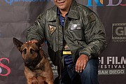 """Sheldon Lettich, screenwriter of """"Max,"""" poses with the dog who plays Max in the film."""