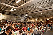 """The audience at the film screening of """"Max"""" at the USS Midway Museum."""