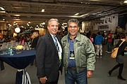 """Tom Karlo, KPBS General Manager, and Sheldon Lettich, screenwriter of """"Max,"""" pose for a picture at the GI Film Festival San Diego."""