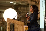 """Laura Law-Millet, co-founder of the GI Film Group, makes a presentation at the film screening for """"Max."""""""