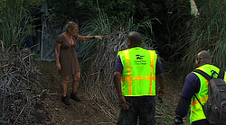 Alpha Project workers offer assistance to a homeless woman near the San Diego River in Mission Valley, Oct. 15, 2015.