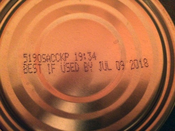 A can of Bumble Bee tuna shows the production code on the...