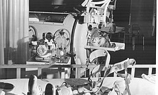 Children with polio in iron lung respirator and...