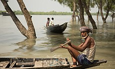 Local people in boats, Sundarbans, Bangladesh. (65723)