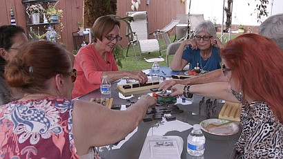 Agnes Conradt and Evie Kosower play Mexican train with their neighbors, Oct. ...