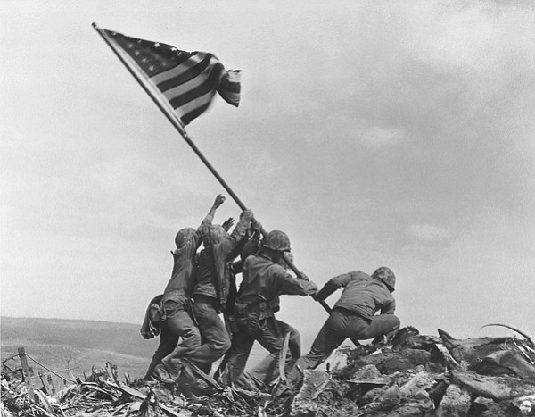 Marines raised the American flag of victory atop Mt. Suribachi on February 23...