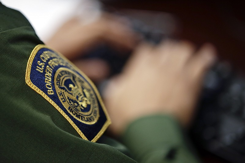 A Border Patrol agent uses a computer in San Diego, Calif., June 5, 2014
