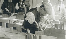 A disabled veteran is taught woodworking as par...