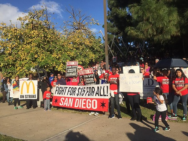 Protesters gathered in downtown San Diego to demand a hig...
