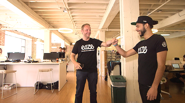 Eaze founder and CEO Keith McCarty gives a fist bump to an Eaze employee whil...