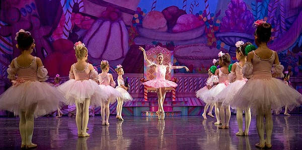 The Sugar Plum Fairy greets her young attendants in San Diego Ballet's