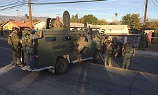 Law enforcement officials with armored vehicles...