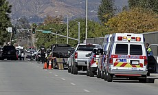 Law enforcement members line up near the the si...