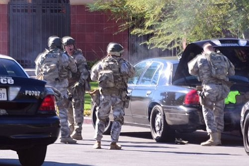A SWAT team arrives at the scene of a shooting in San Ber...
