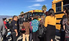 Evacuees from the scene of a mass shooting in S...