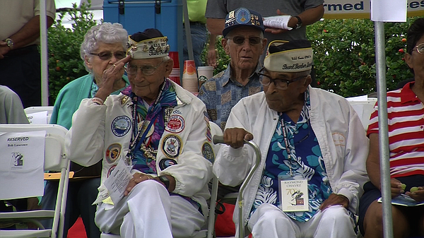 Pearl Harbor survivors Stu Hedley, left, and Ray Chavez a...