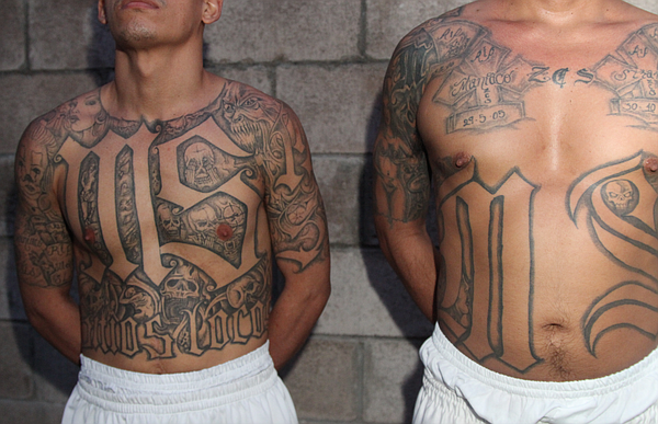 Two members of the Mara Salvatrucha (MS-13) stand in a prison in El Salvador ...